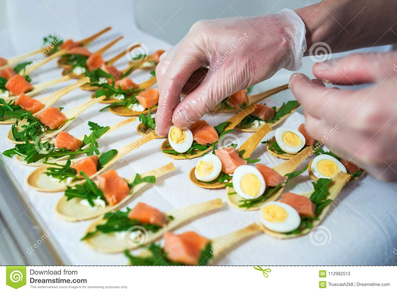 Delicates, appetizer filling with red fish and greens. Catering service.