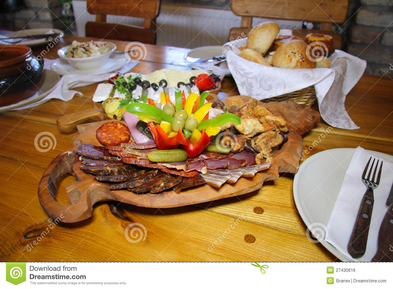 Delicatessen food on a wooden plate stock photo image for Cuisine wooden