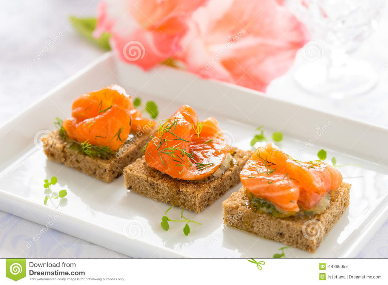 Delicious appetizer canapes of black bread with smoked for Canape appetizers