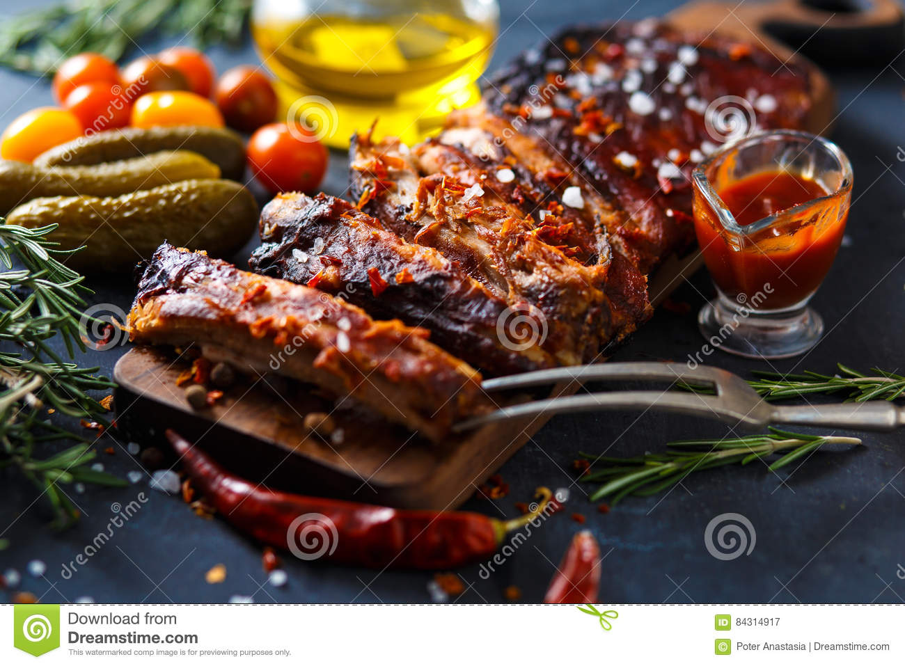 Delicious barbecued ribs seasoned with a spicy basting sauce and served with chopped