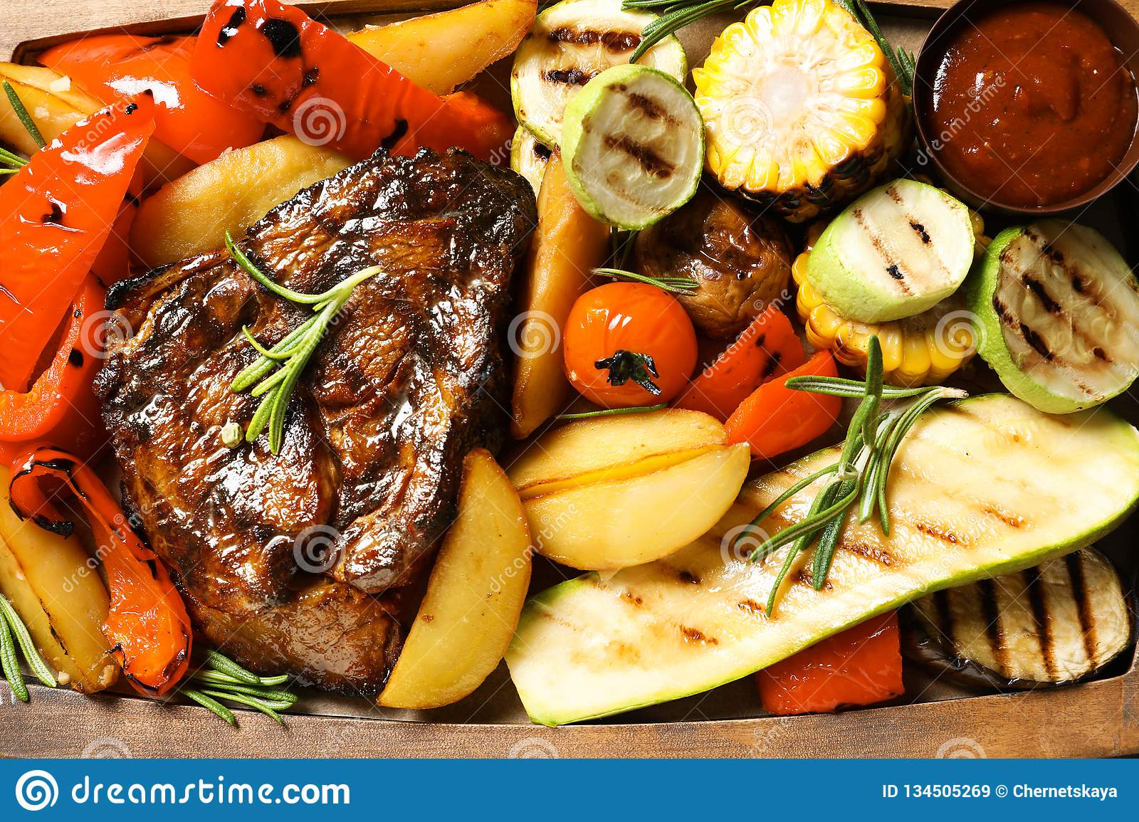 Delicious barbecued steak served with garnish and sauce