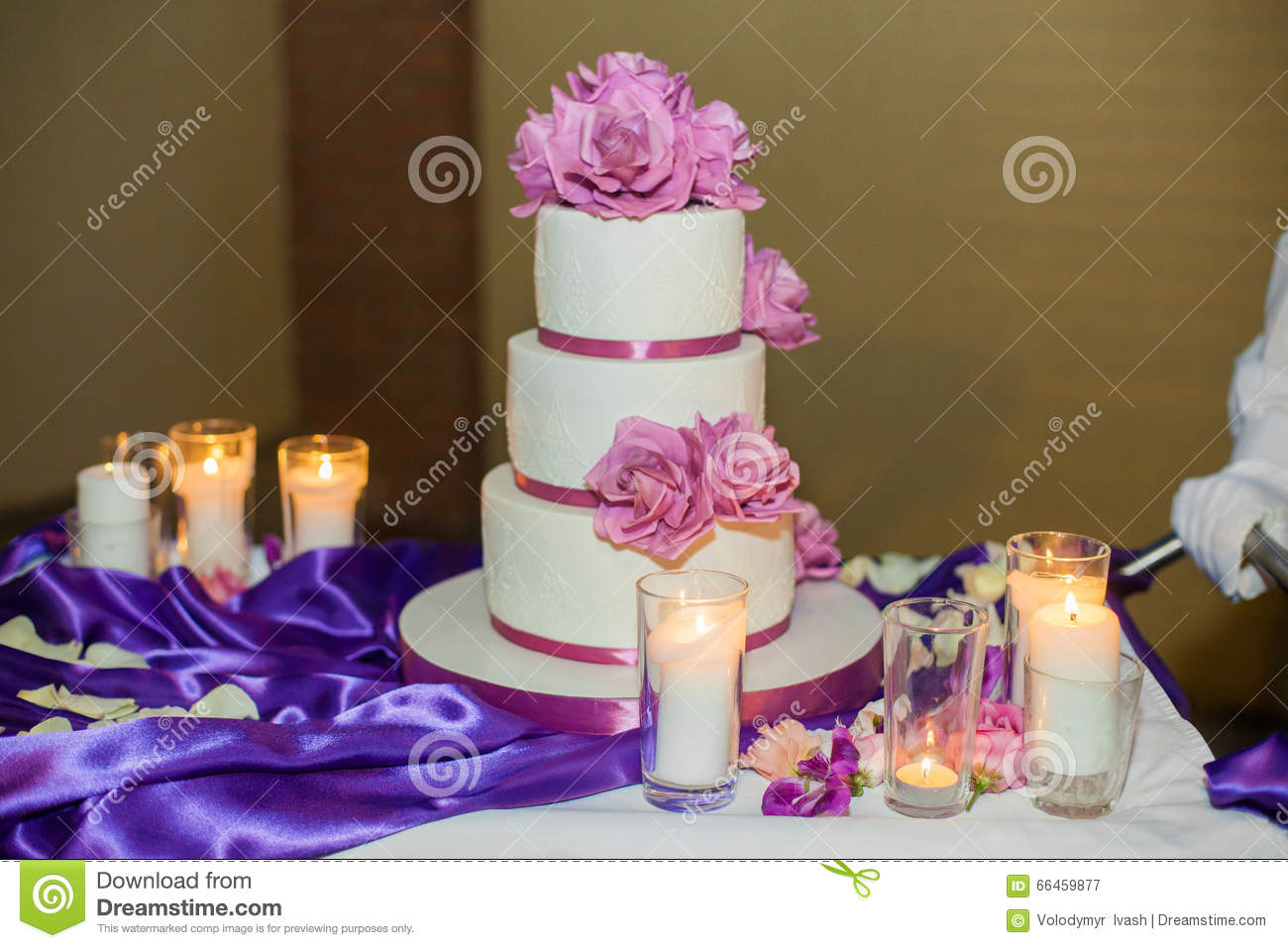 Delicious Beautiful White Wedding Cake With Purple Flowers Stock