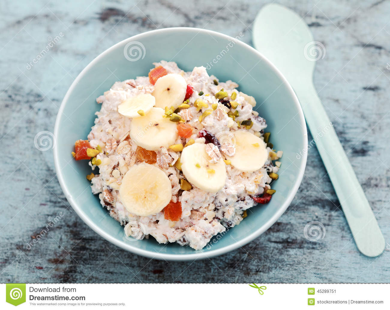Delicious bowl of muesli with fruit and nuts