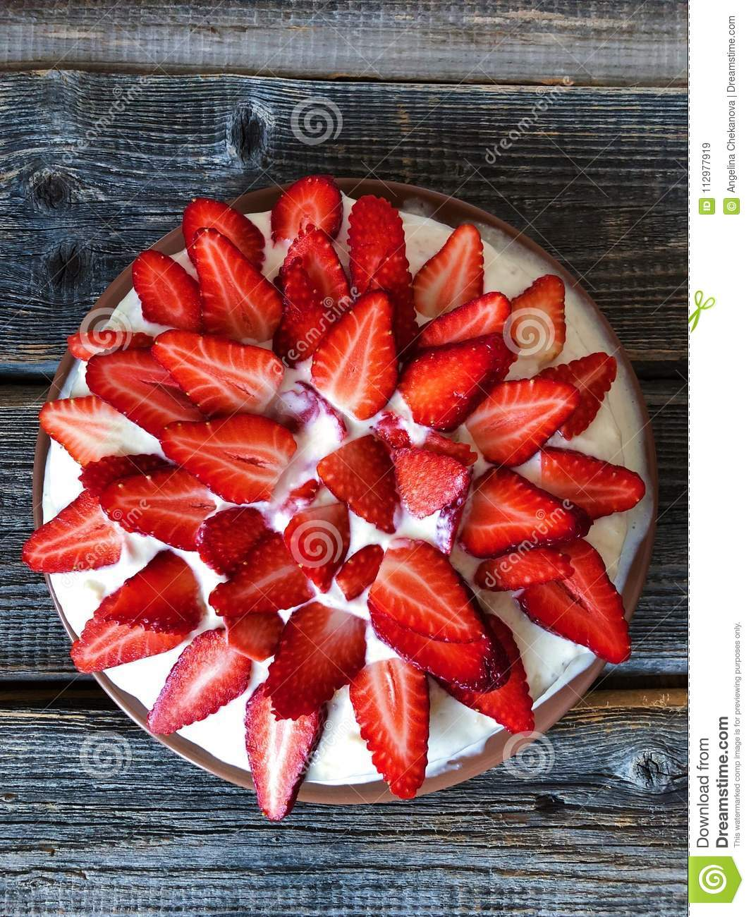 Delicious cake with fresh strawberries and cream