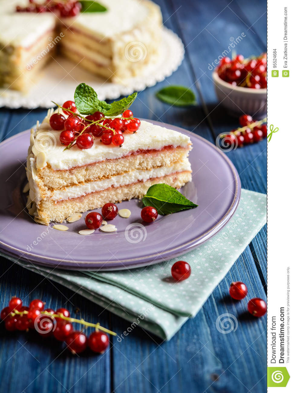 Delicious cake with mascarpone, whipped cream, red currant and almond slices