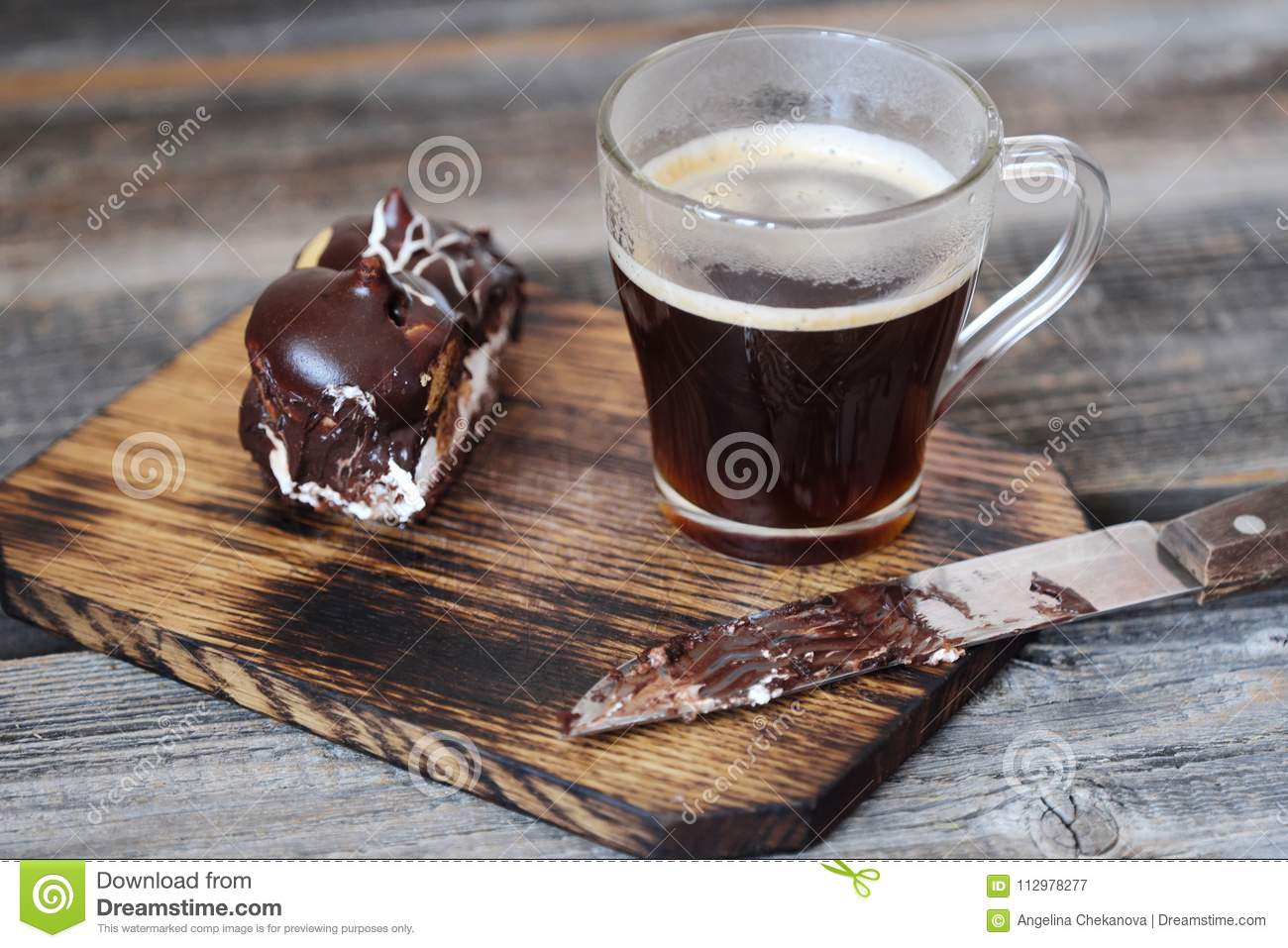 Delicious chocolate dessert with profiteroles and coffee
