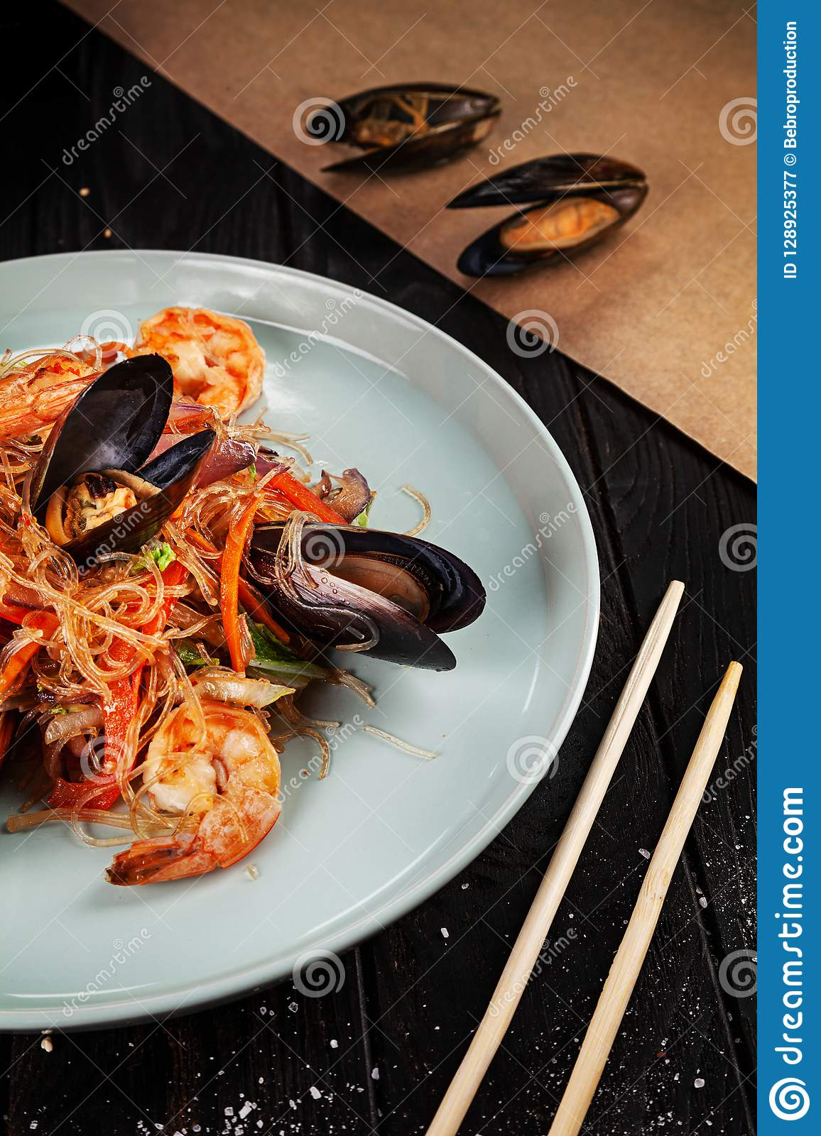 Delicious close up view on Chinese noodles with mussels.
