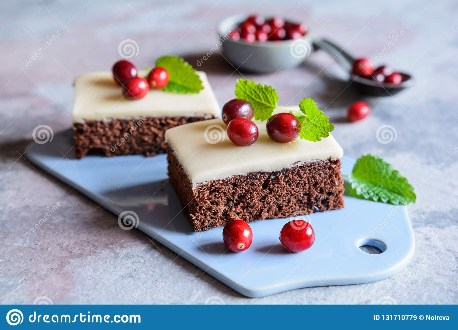 Cocoa cake with cranberries and marzipan glaze
