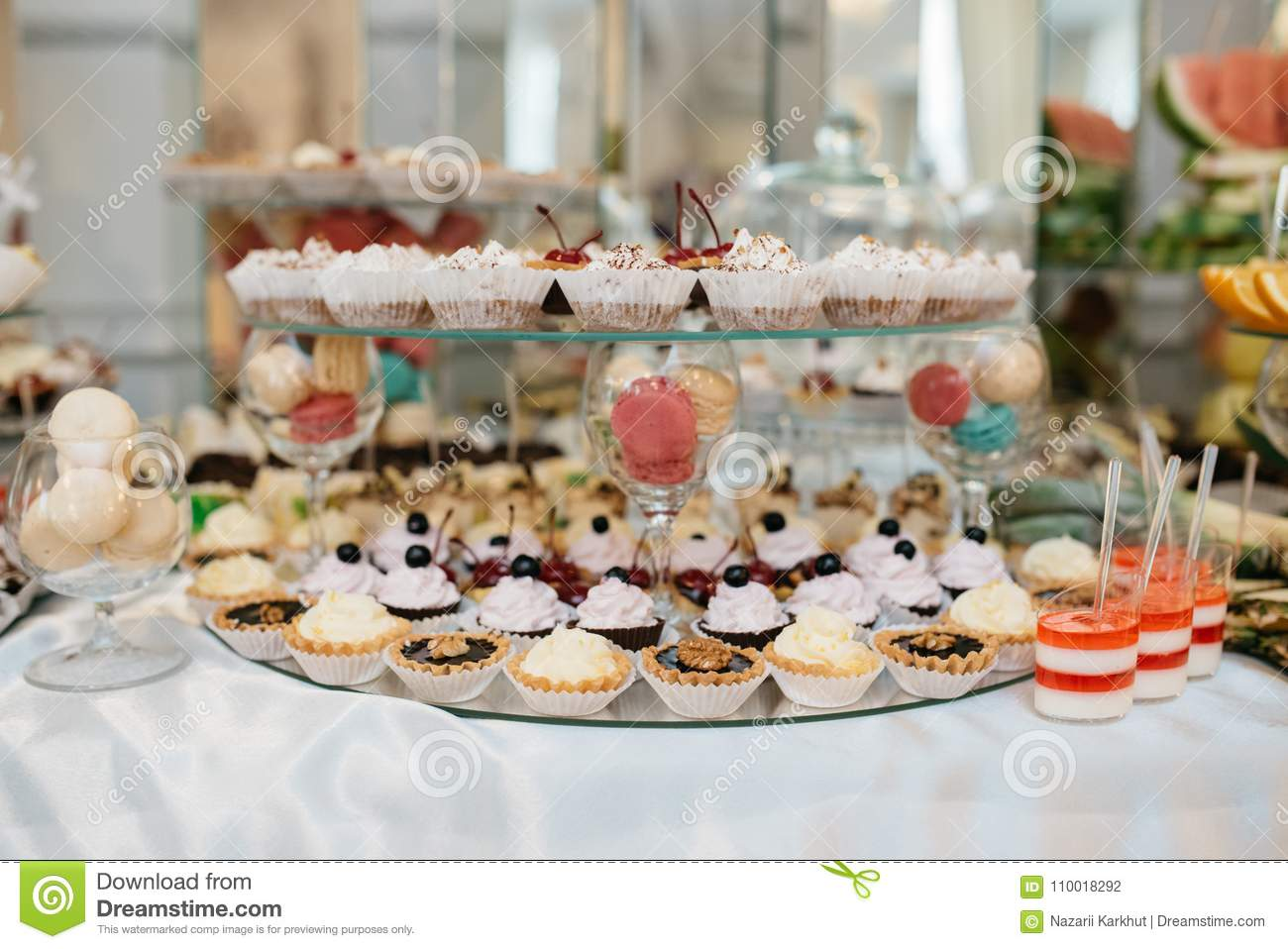 Delicious Decorated Candy Bar Sweets On Tables For Wedding
