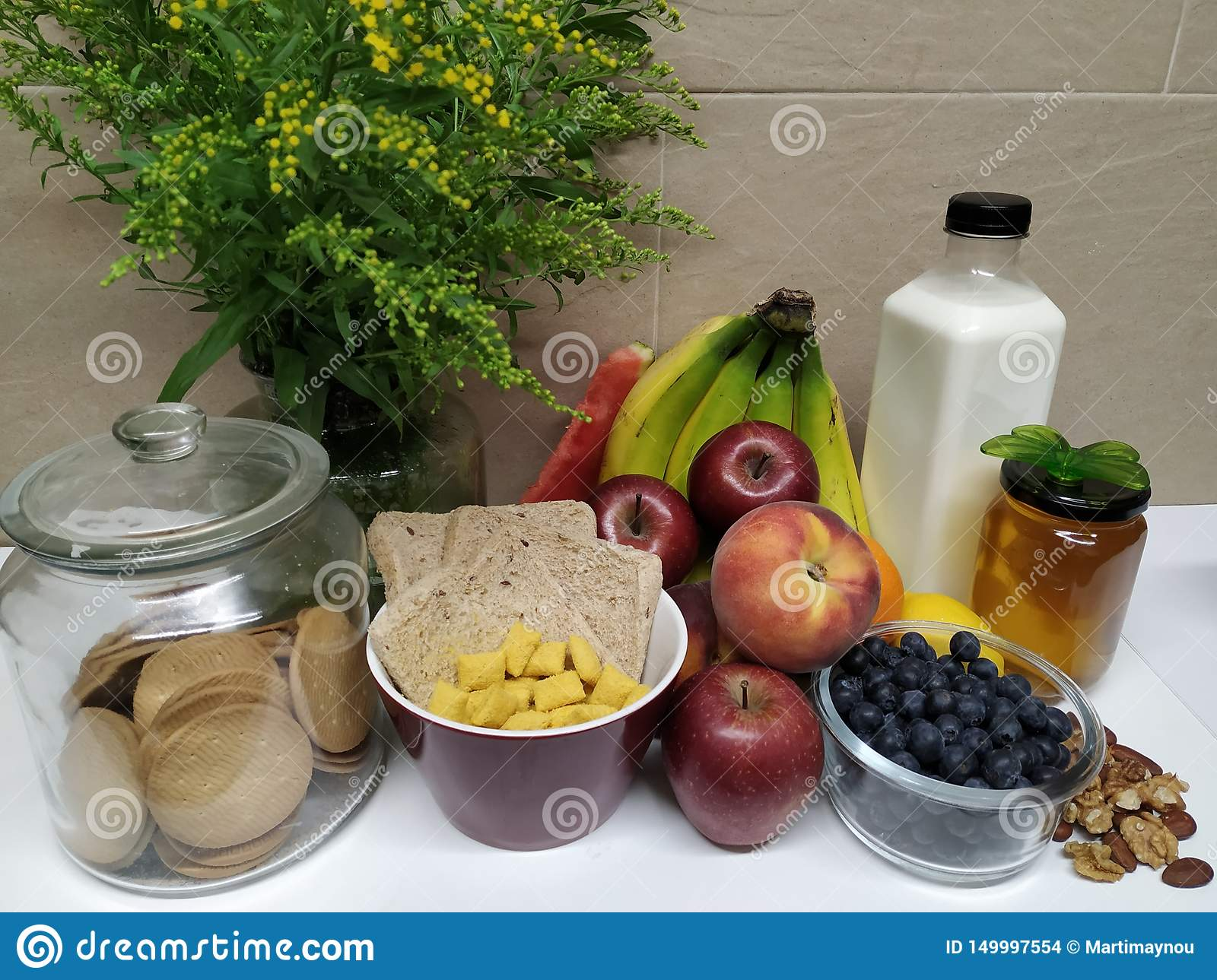 Healthy breakfast with assortment of fruits and flowers
