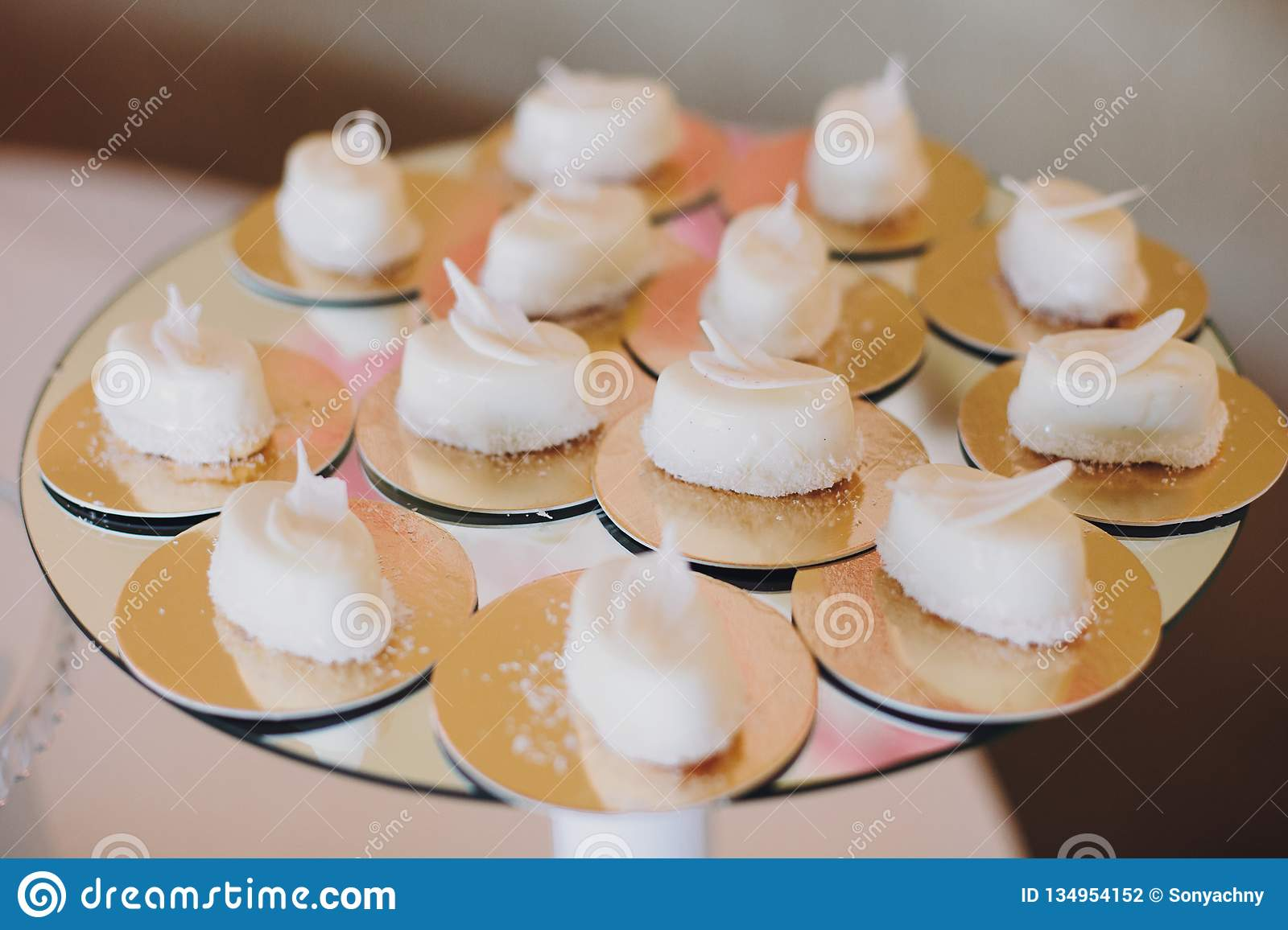 Delicious desserts and sweets on table party at wedding reception. White and pink stylish candy bar. Christmas and New Year feast