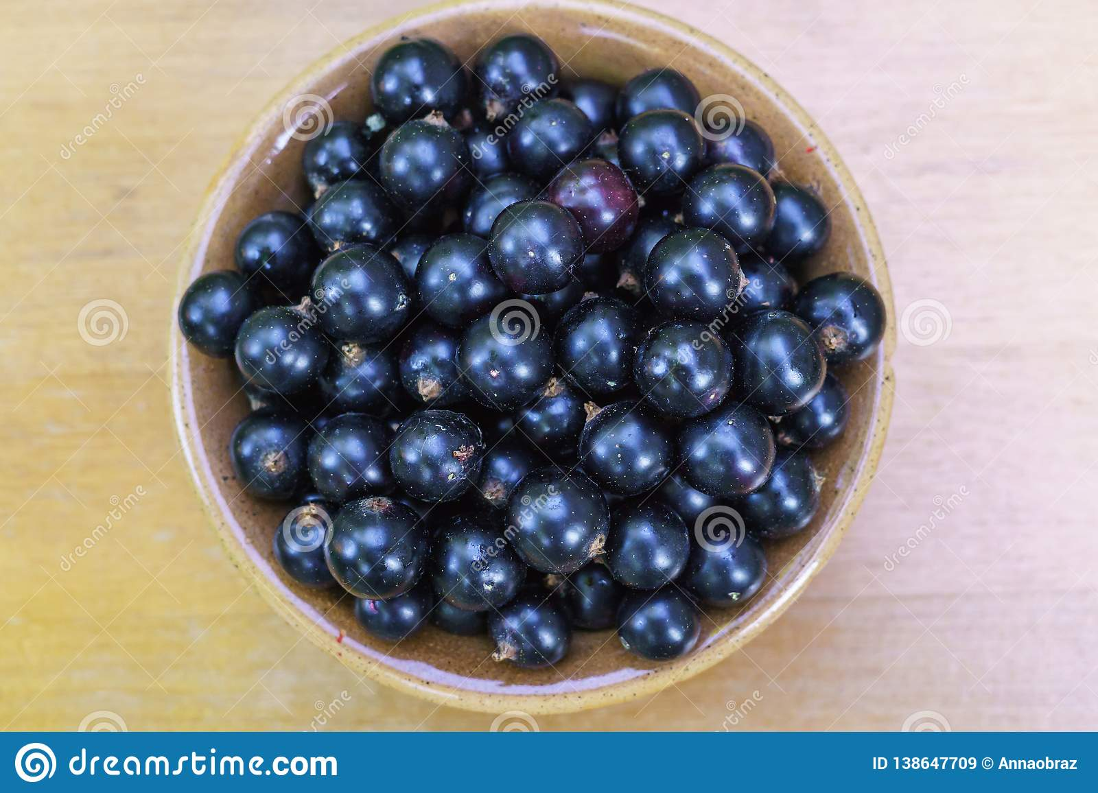 Delicious, fragrant black currant berries in a bowl on the table