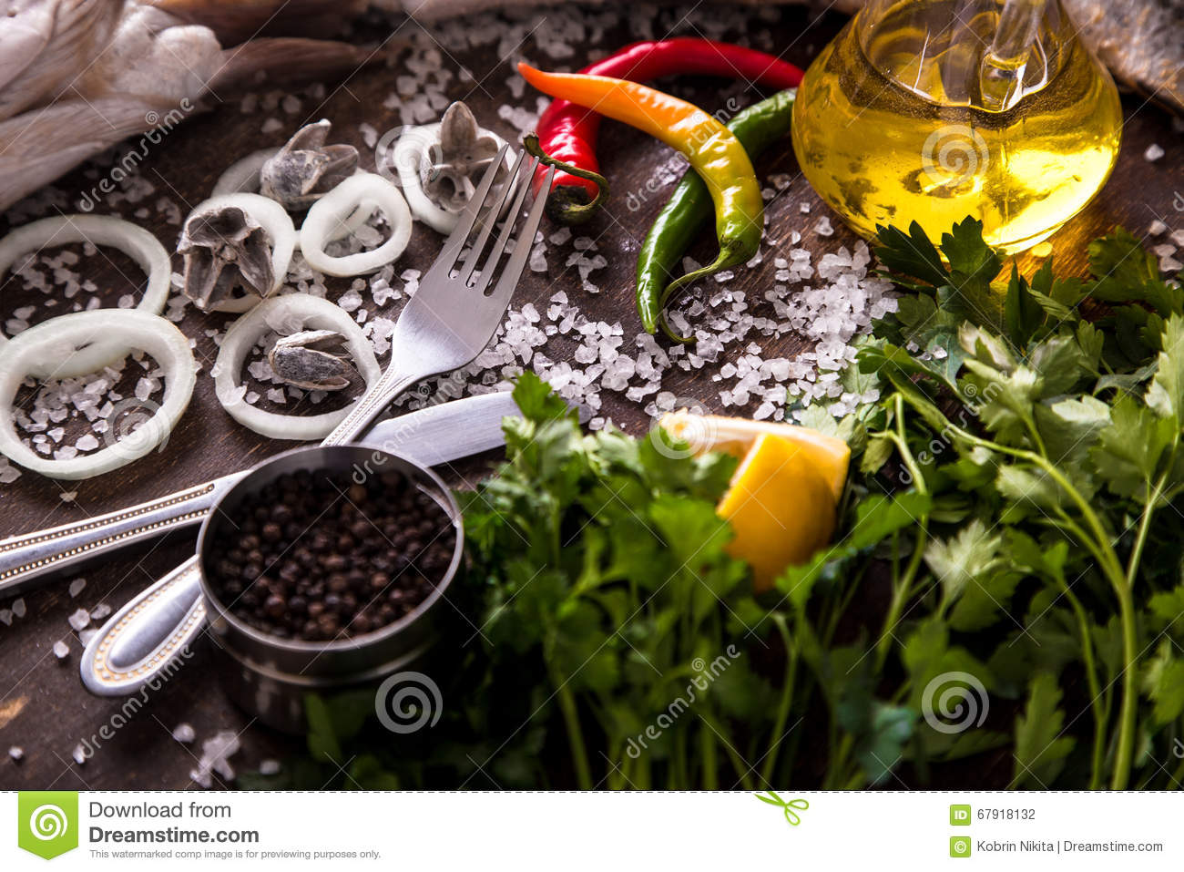 Delicious Fresh Fish With Aromatic Herbs, Spices And Vegetables On ...