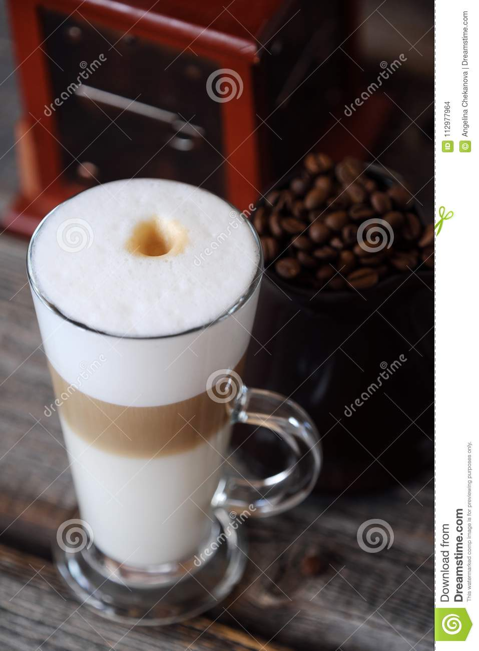 Delicious fresh latte coffee on wooden table