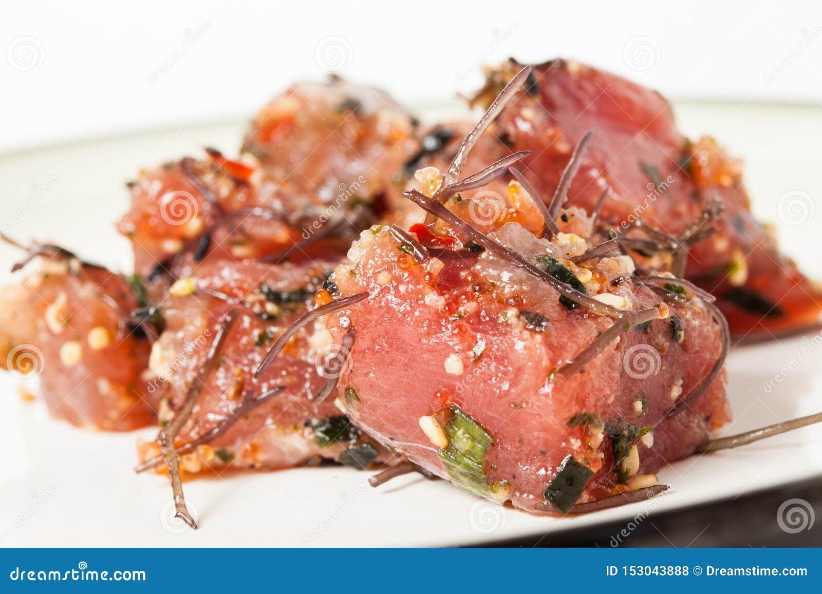 Delicious Hawaiian Poke Raw Fish Prepared with Onions and Seaweed