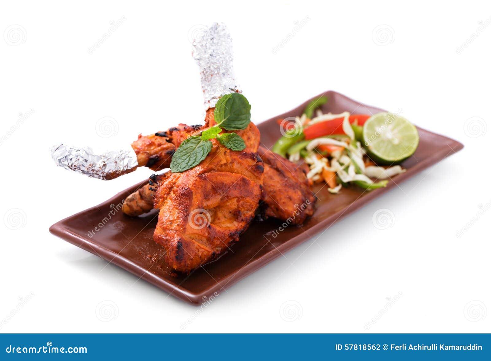 Delicious, indian tandoori chicken served with salad