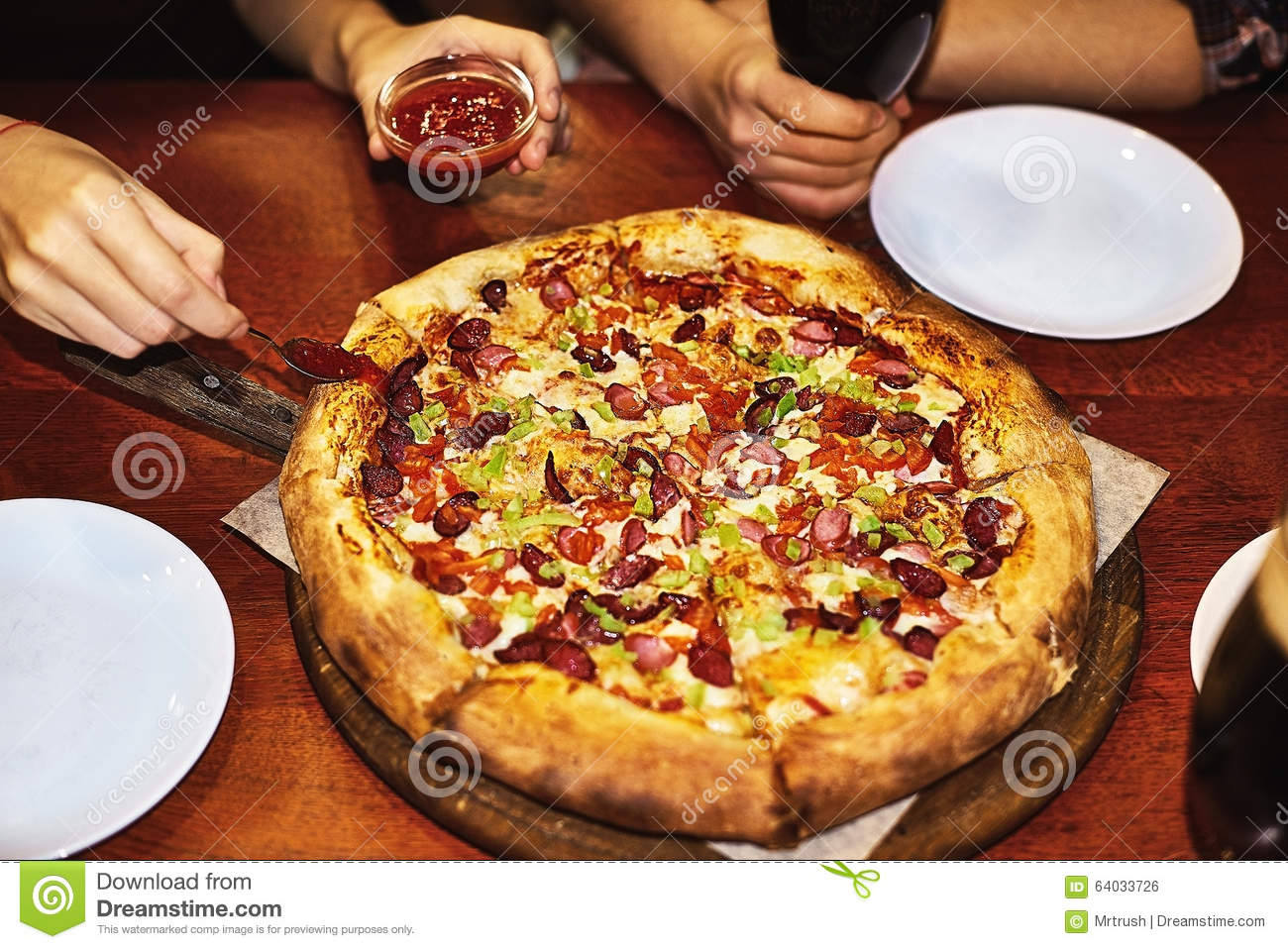 Delicious italian pizza served on table stock photo for Table a pizza