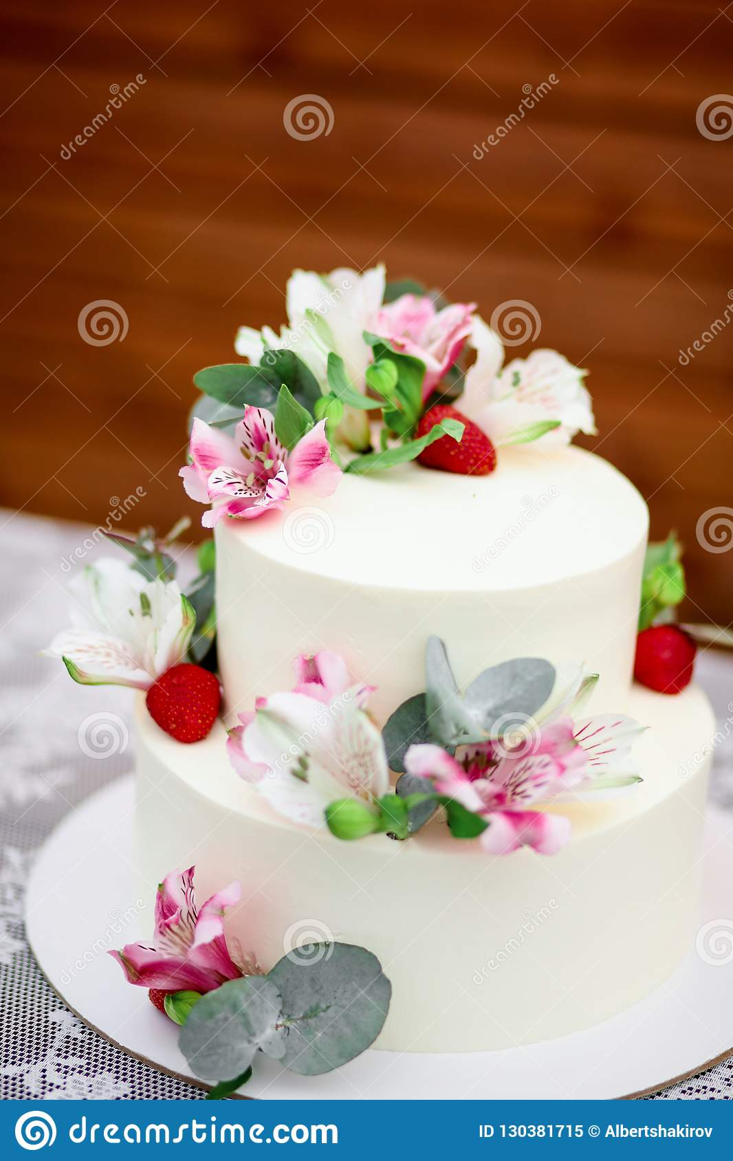 Stupendous Delicious Wedding Cake Decorated White Icing With Exotic Flowers Funny Birthday Cards Online Overcheapnameinfo