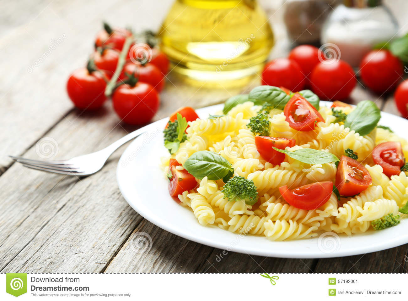 Delicious pasta on plate on grey wooden background.