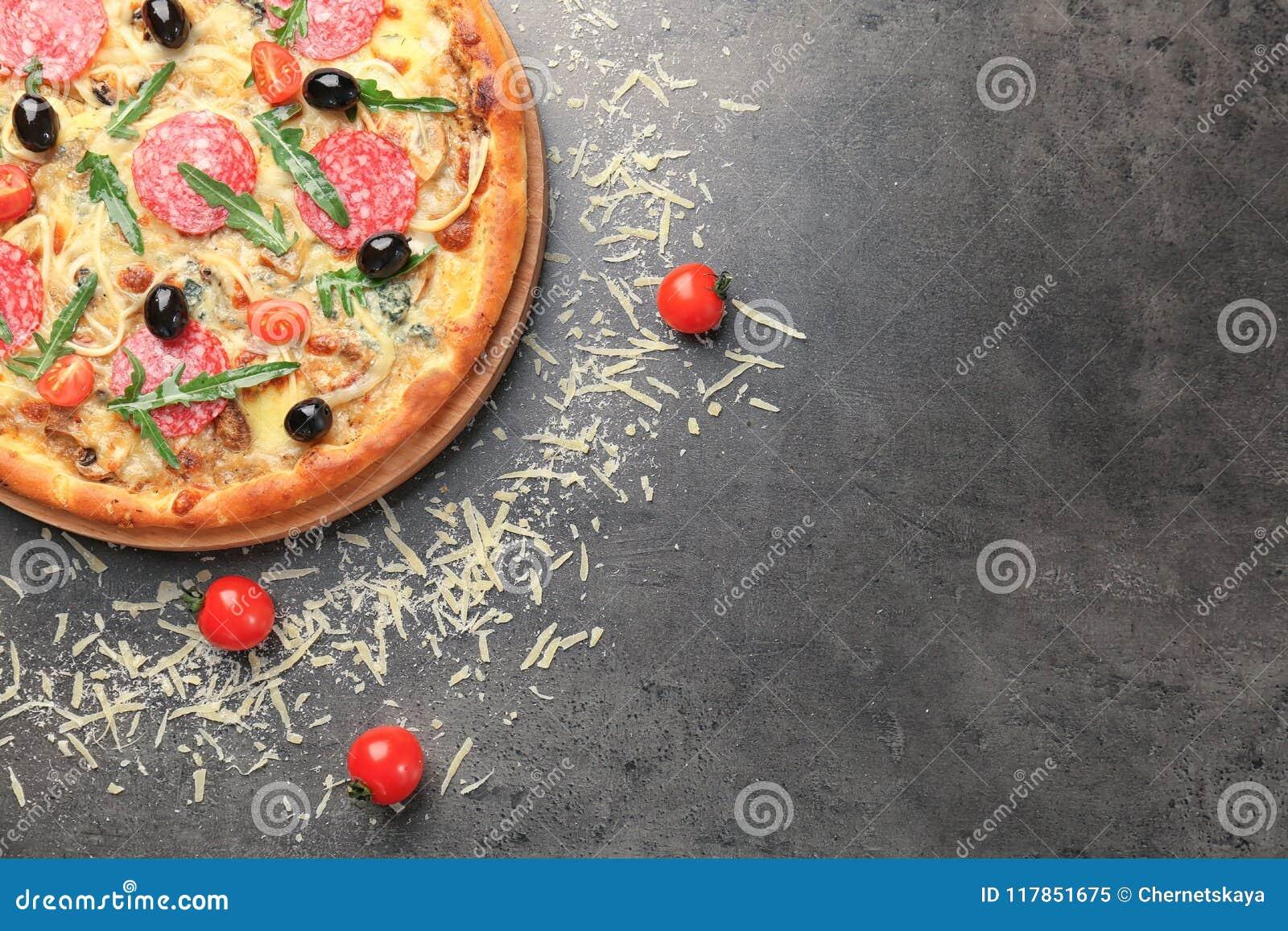 Delicious pizza with tomatoe