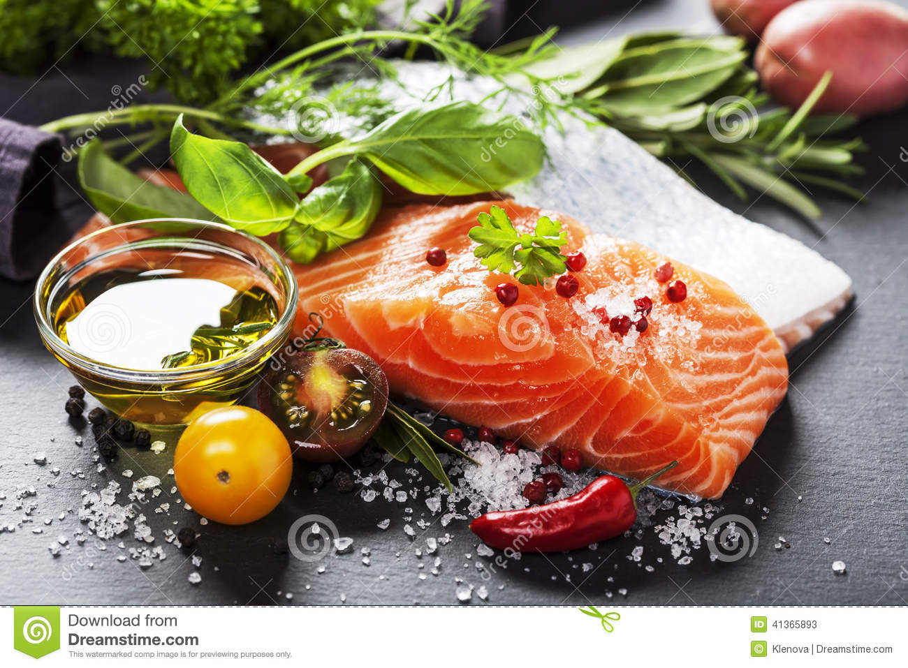 Delicious portion of fresh salmon fillet with aromatic herbs,