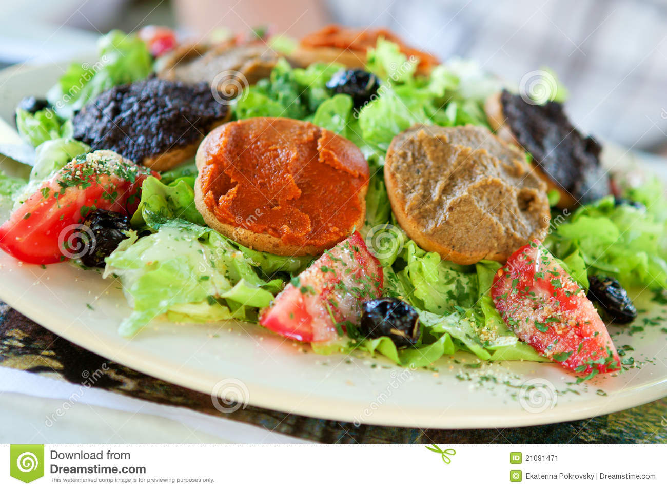 Delicious Provencal salad: fresh vegetables, olives, olive oil and ...