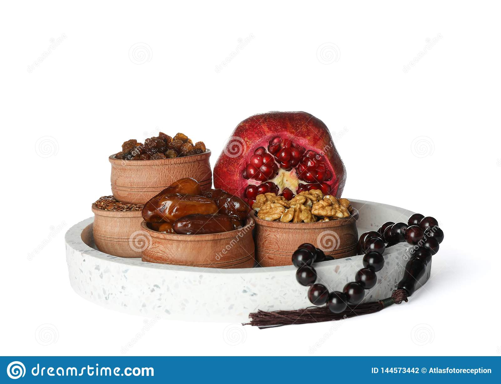 Delicious ramadan food with prayer beads isolated