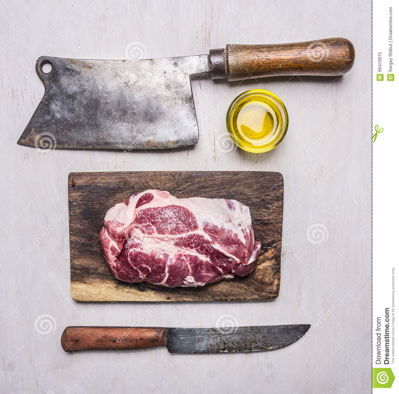 delicious raw pork steak on a cutting board with a meat cleaver and a knife for meat on wooden. Black Bedroom Furniture Sets. Home Design Ideas
