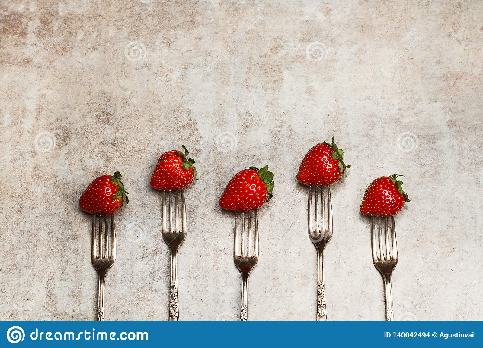 Delicious red strawberries punctured on forks