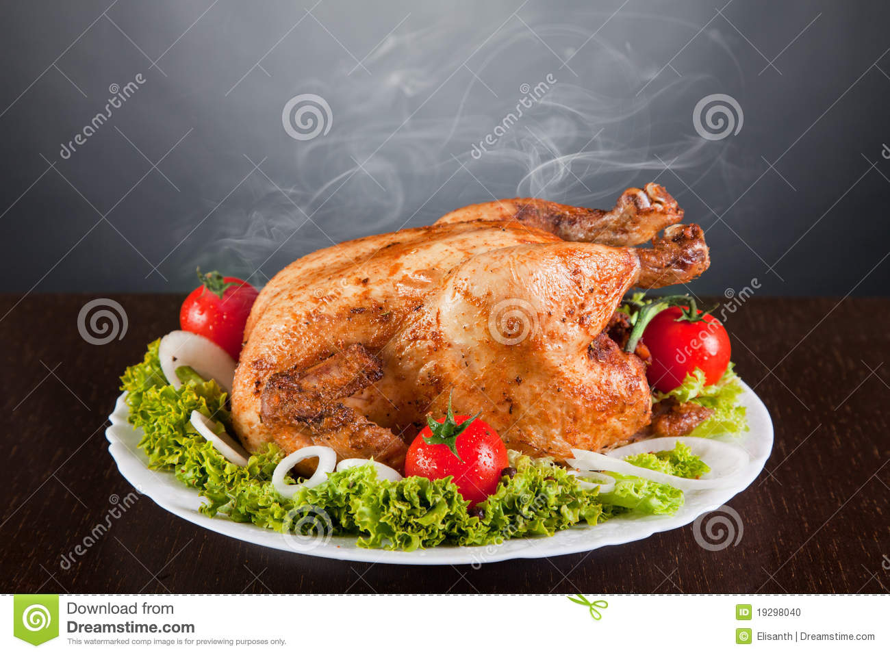 Delicious roast chicken with red tomatoes