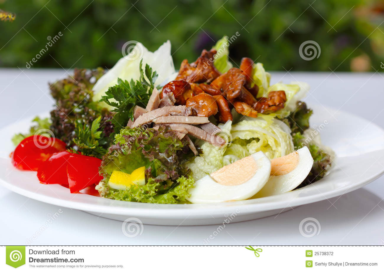 Delicious salad with greens and mushrooms