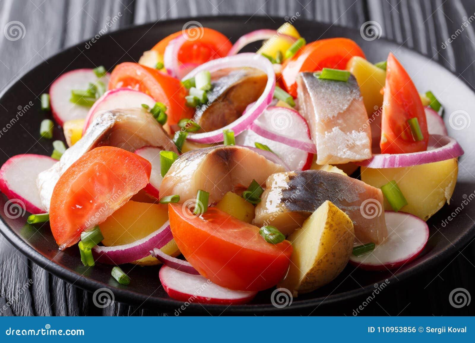 Delicious salad of smoked mackerel with potatoes, radish and tom