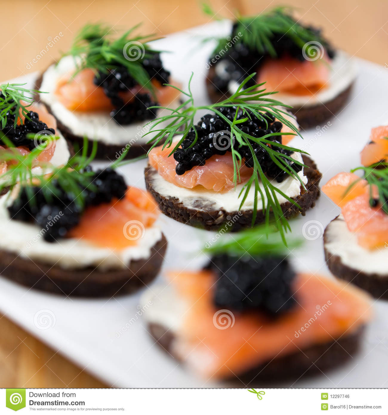Delicious snack with salmon and caviar royalty free stock for Canape with caviar