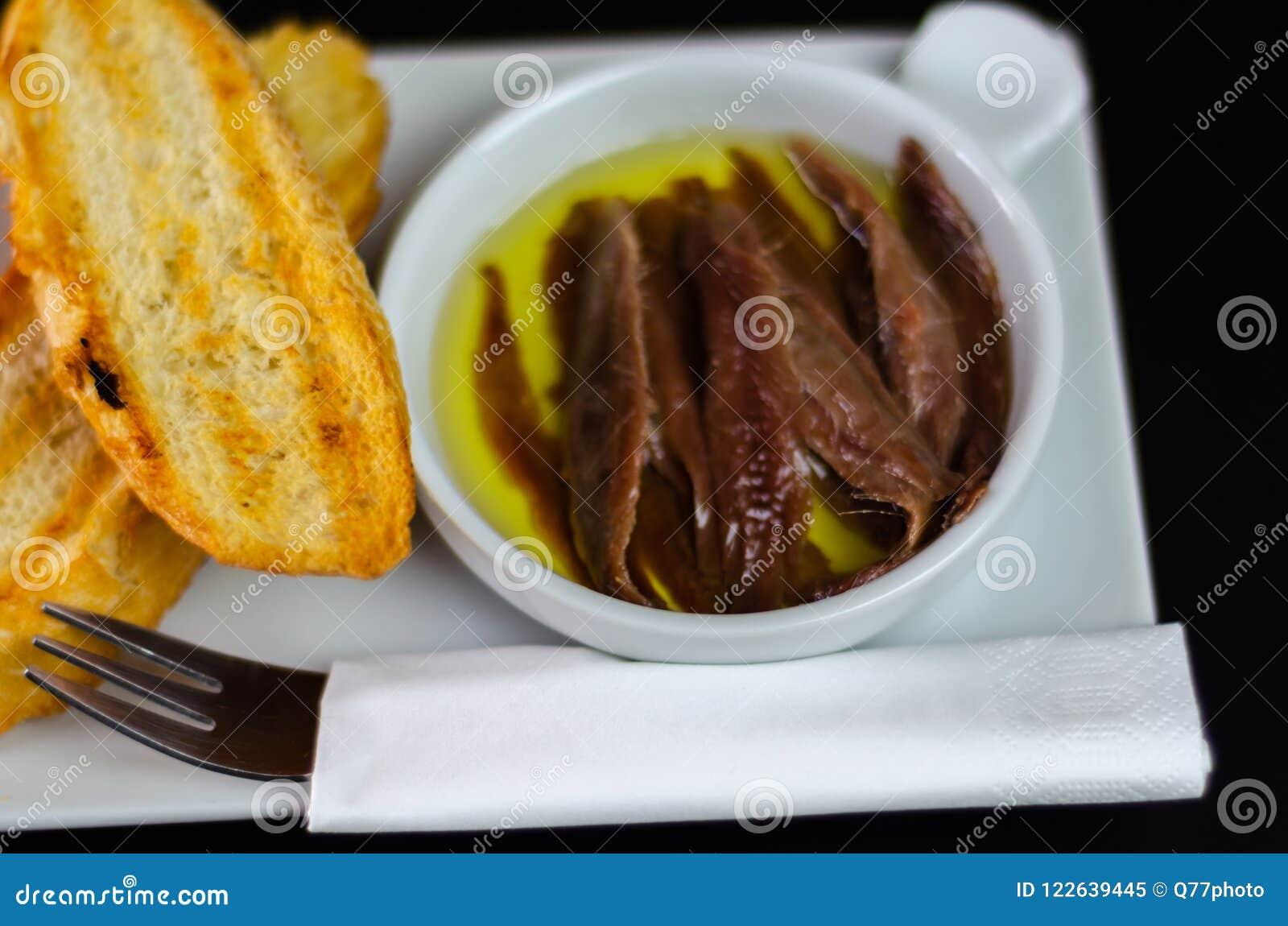 delicious spanish snack fresh fish marinated in olive oil serv