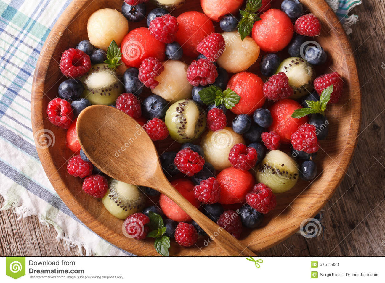 Juicy raspberries in a wooden bowl Place for text The