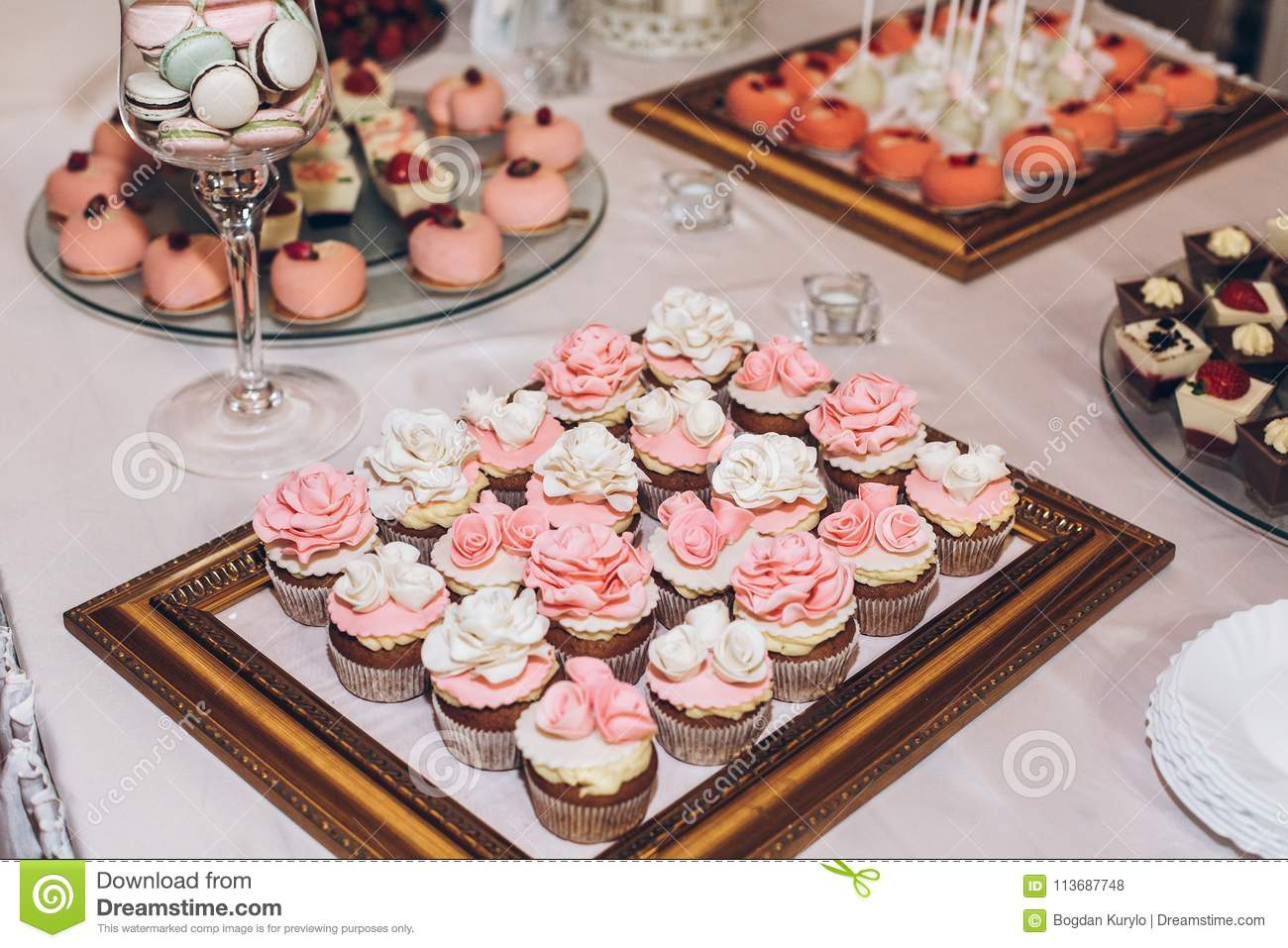 Delicious Sweets Cupcakes With Roses,pops And Candy On Table At ...