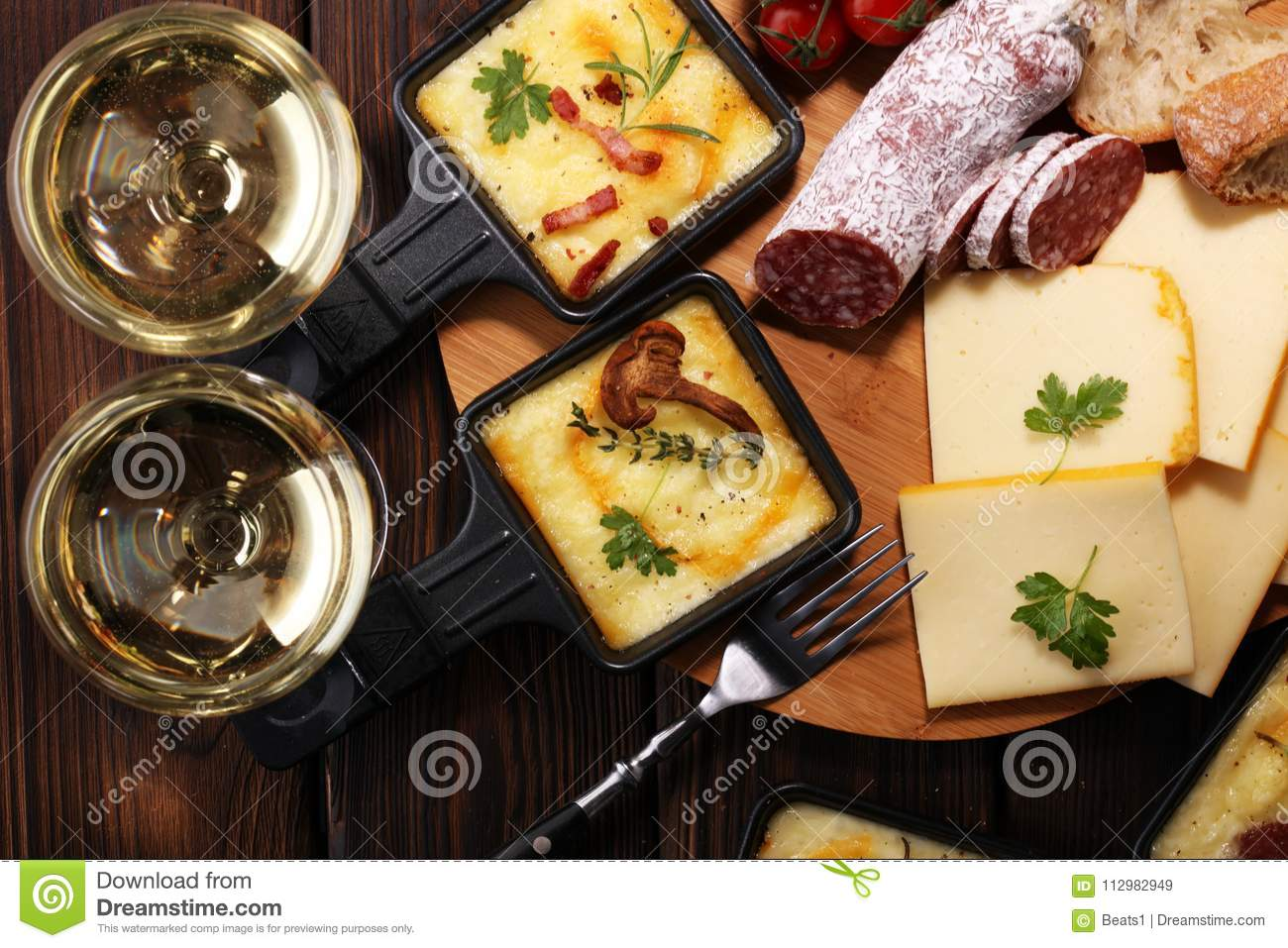 Delicious traditional Swiss melted raclette cheese on diced boil