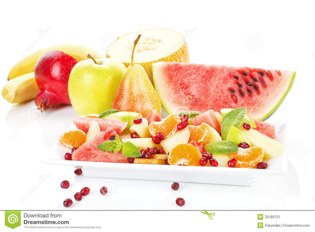 Colorful fruit salad and fruits on white plate isolated. Fresh summer ...