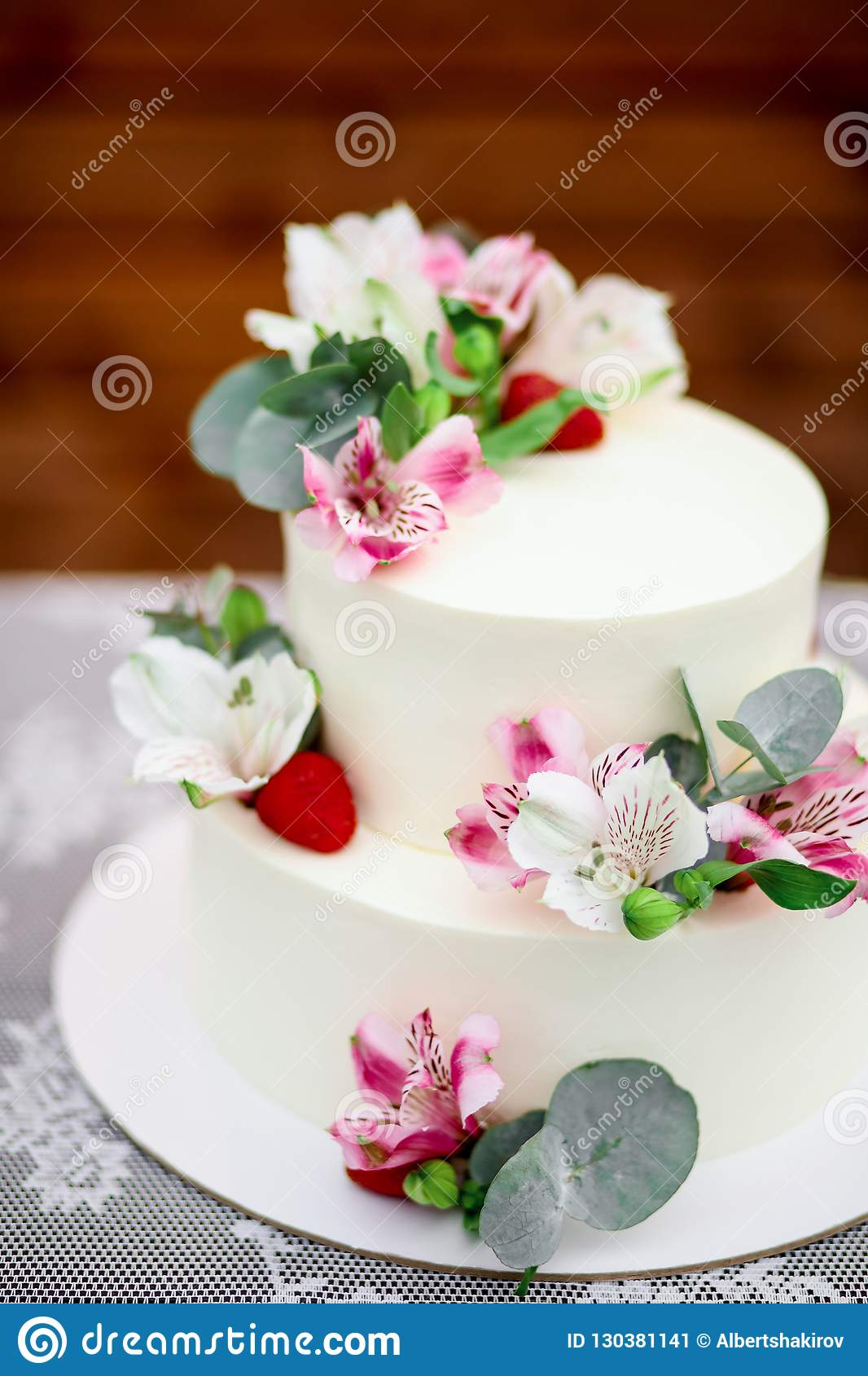 Super Delicious Wedding Cake Decorated White Icing With Exotic Flowers Funny Birthday Cards Online Overcheapnameinfo