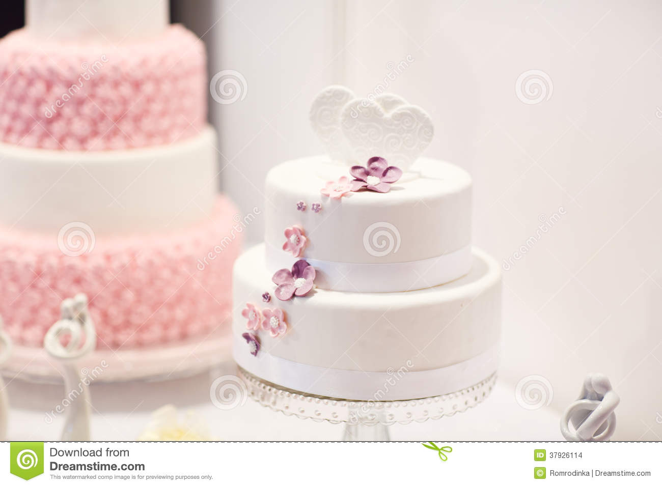 Delicious Wedding Cake In White Creme And Pink Stock