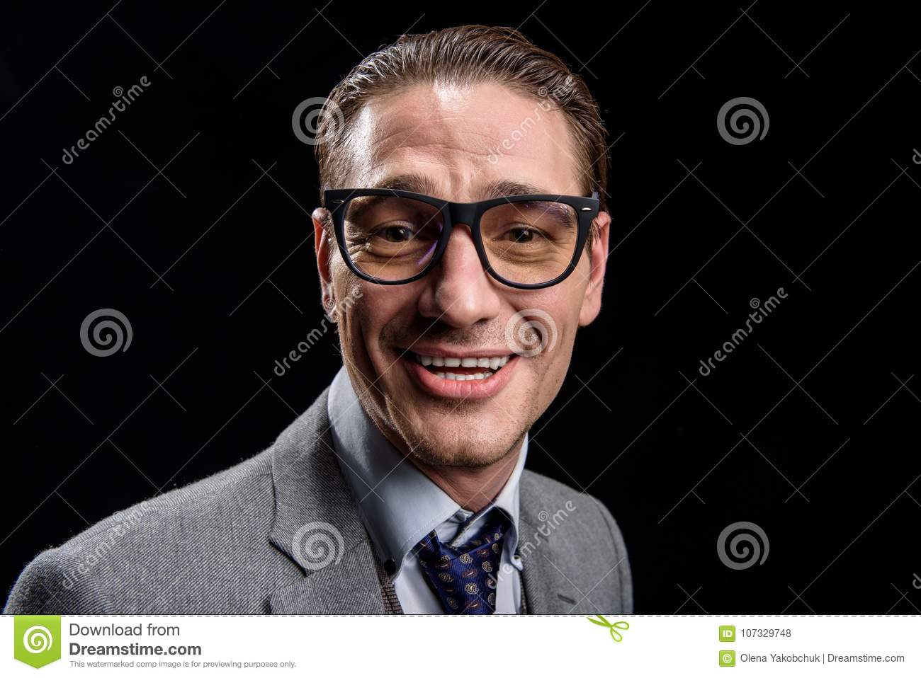 Delighted stylish businessman is expressing gladness