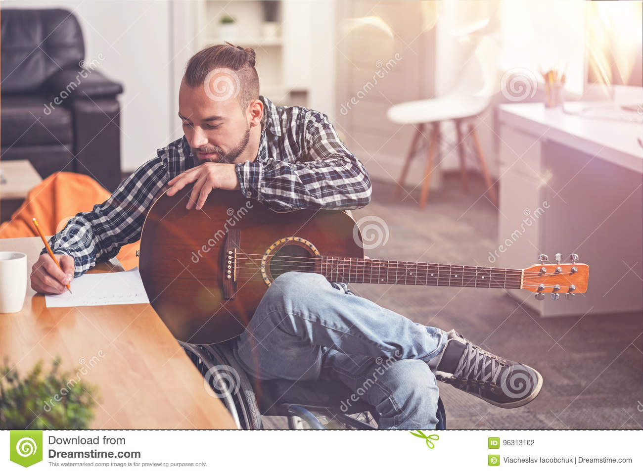 Delighted stylish man leaning on his guitar