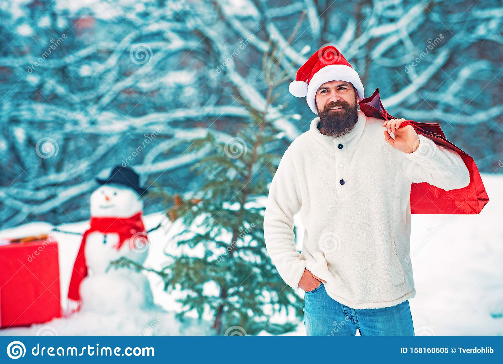 Delivery gifts. Cute little snowman and bearded man with shopping bag. Hipster santa claus. Funny snowman with shopping