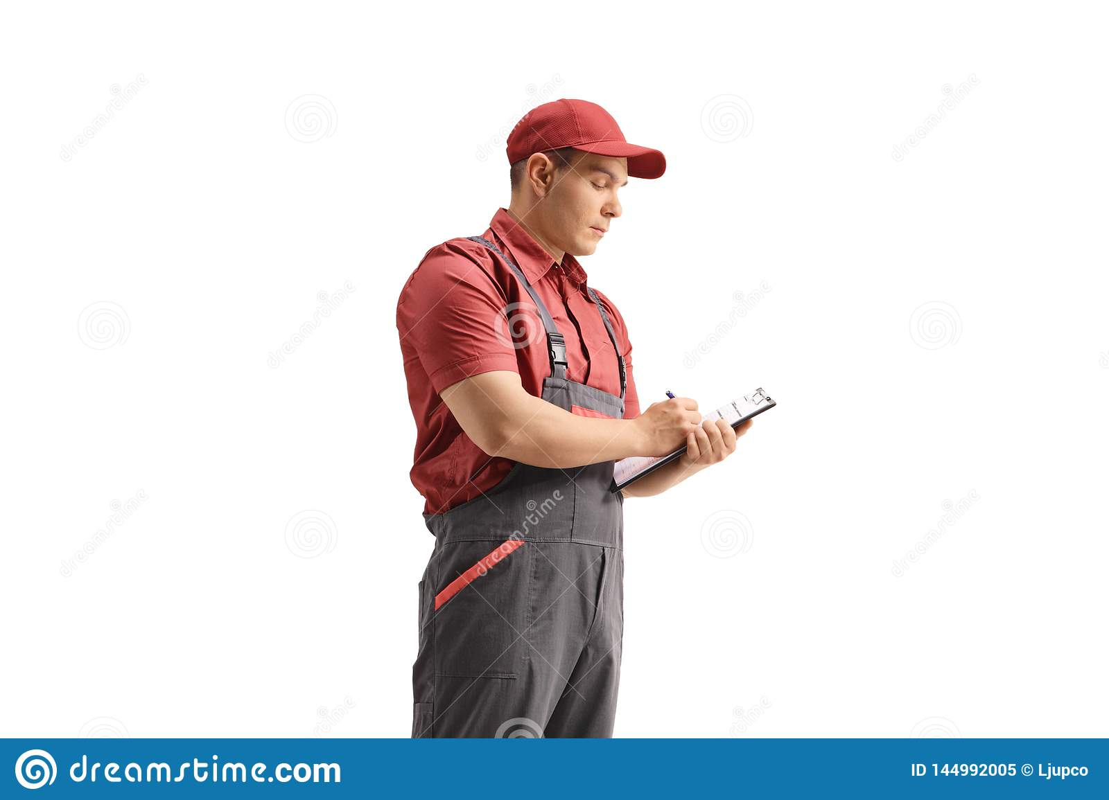 Delivery guy writing in a clipboard