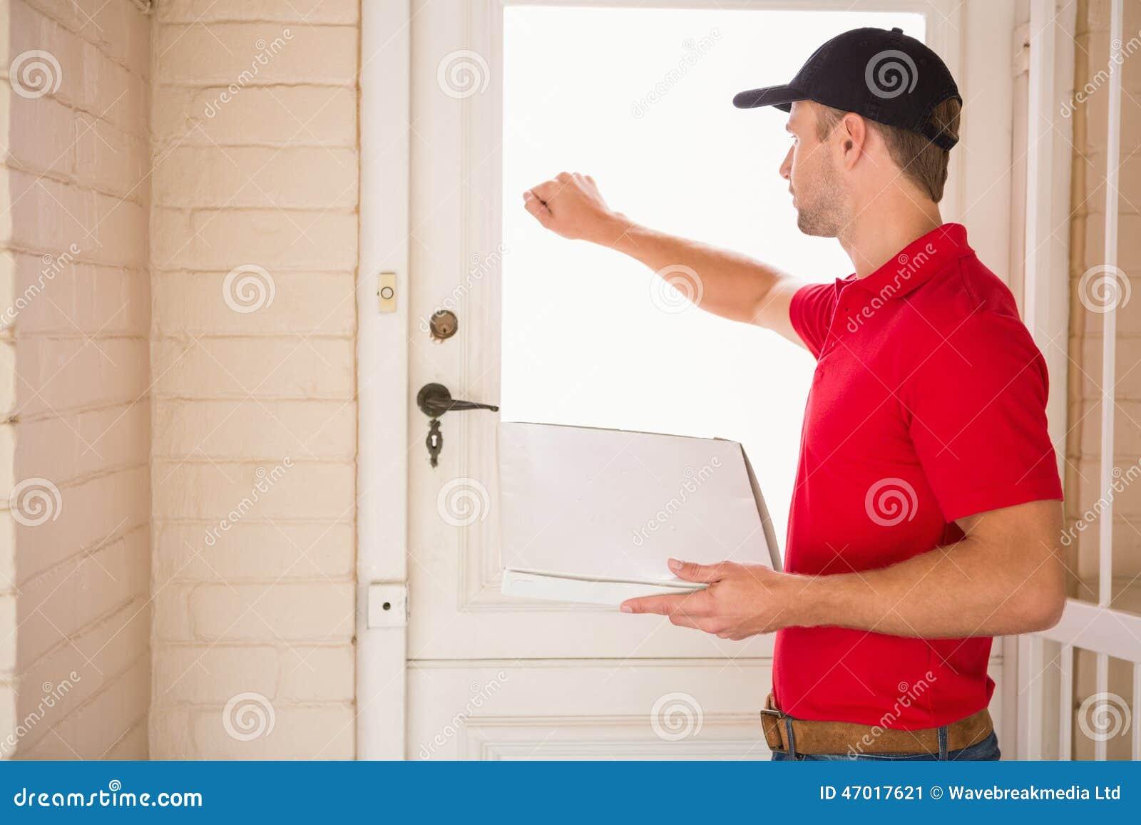 Man with car key autos post for Door 2 door pizza