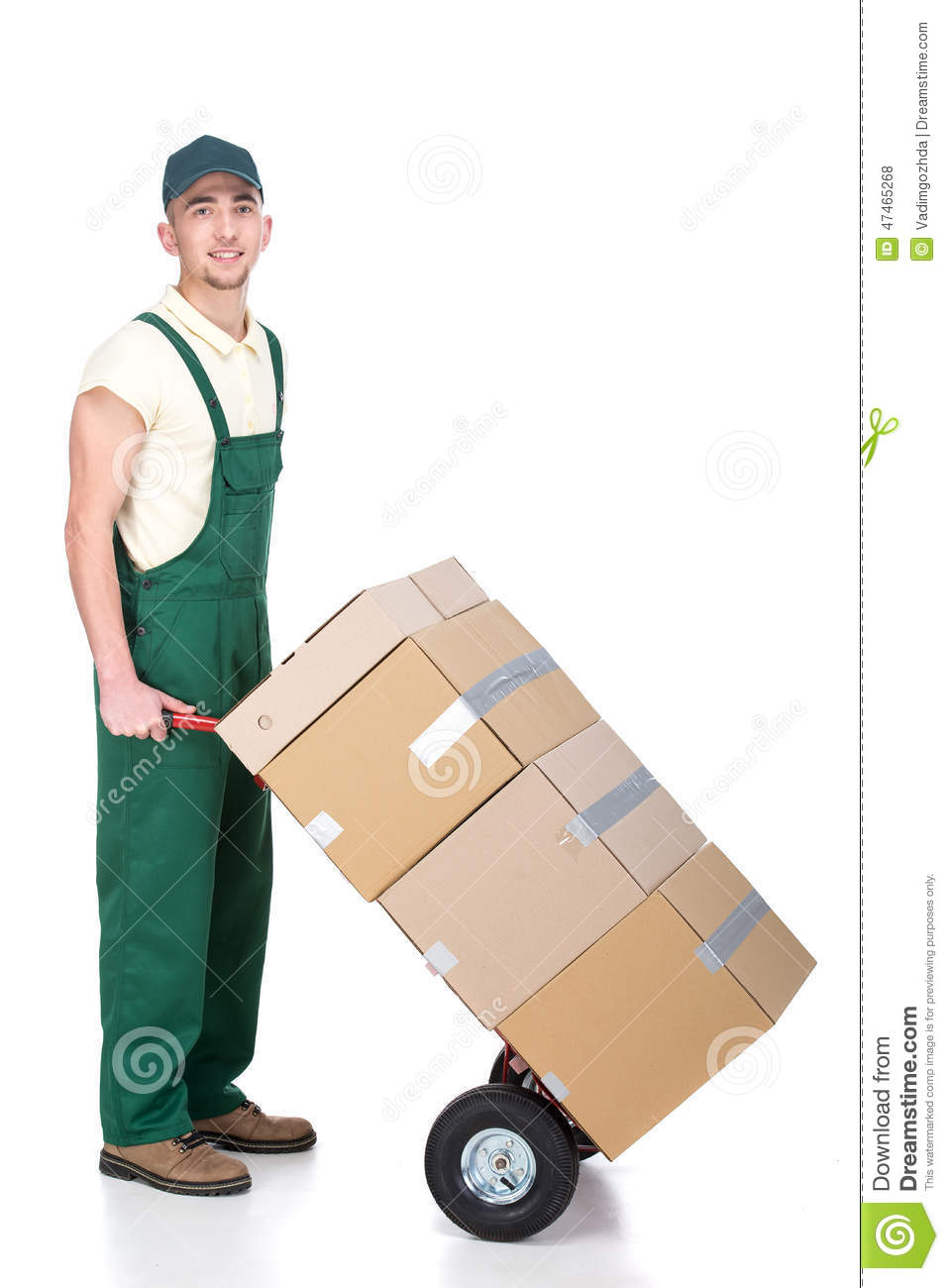 Delivery man is pushing hand truck with pile of boxes.