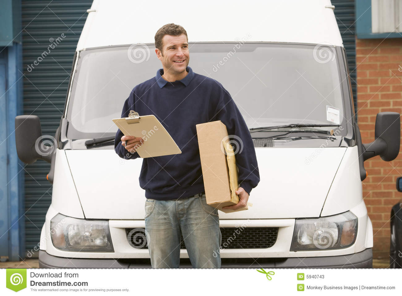 Delivery Person Standing With Parcel And Clipboard Stock Photos ...