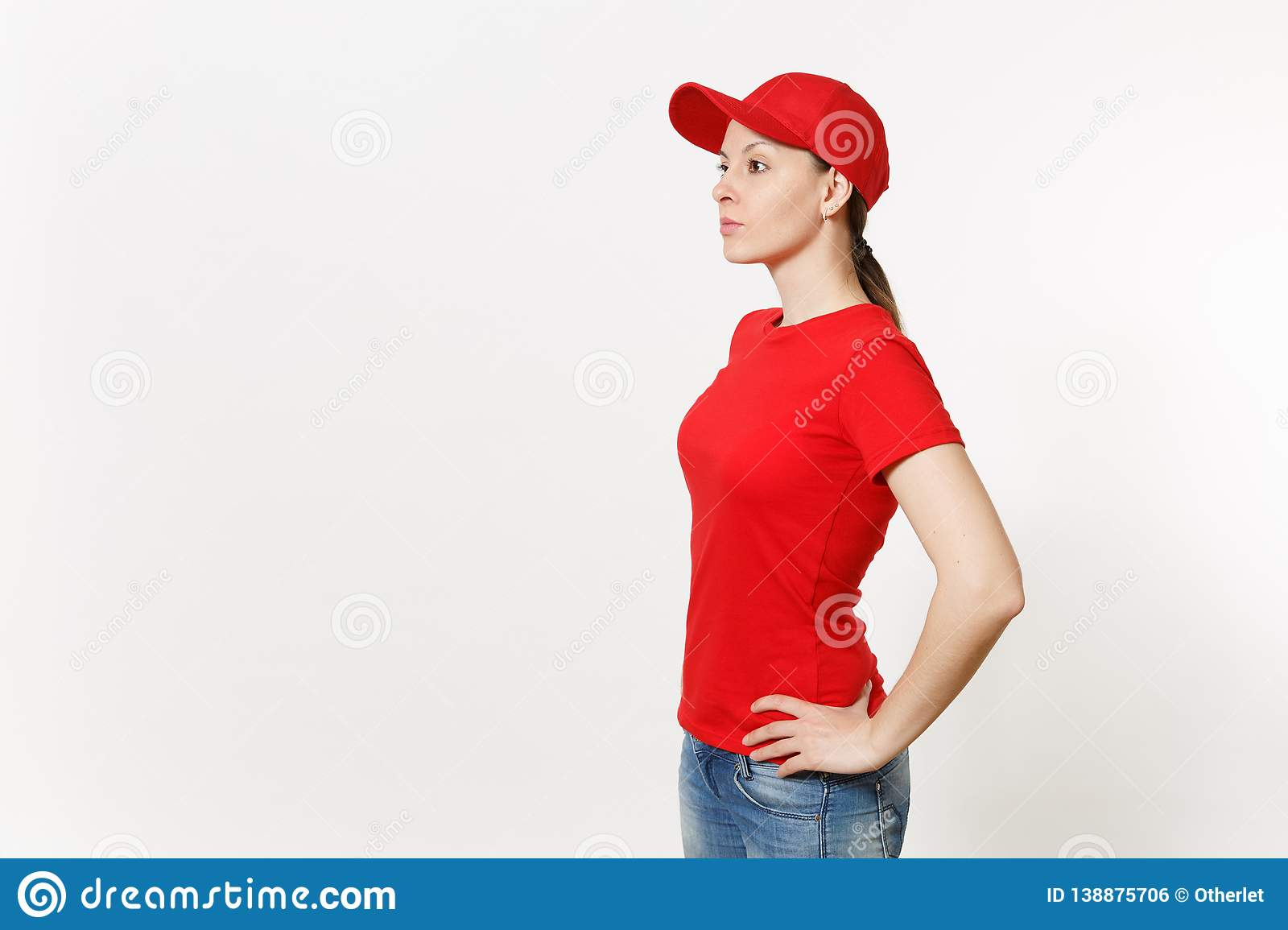 Delivery woman in red uniform isolated on white background side view. Professional female in cap, t-shirt, jeans working
