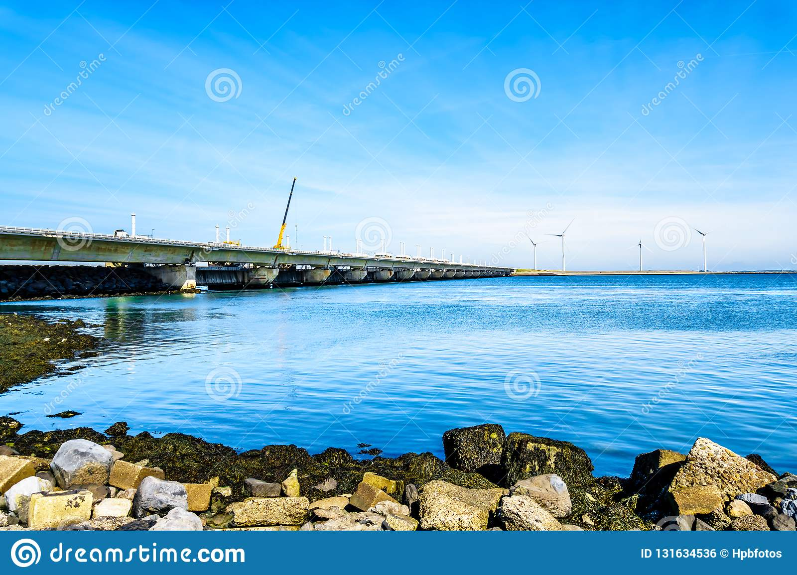 The Delta Works Storm Surge Barrier and Wind Turbines at the Oosterschelde viewed from Neeltje Jans island