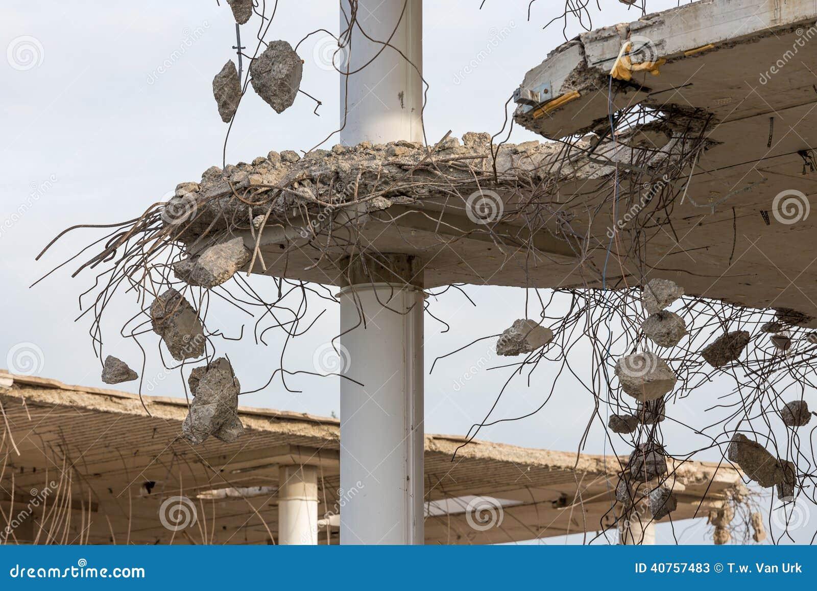 Demolition of a concrete building stock image image for Floor pillars